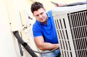 image of HVAC contractor installing air conditioning system